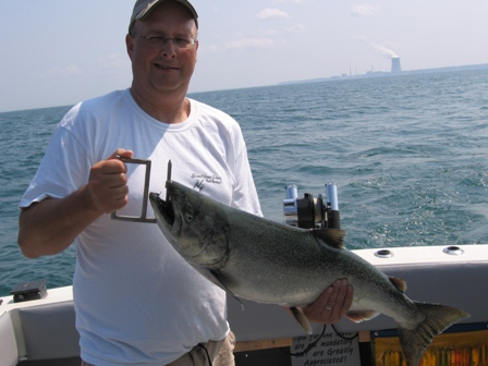 Lake Ontario Area Charter Photos with TSI Charters - dave with a fiesty Lake Ontario King Salmon