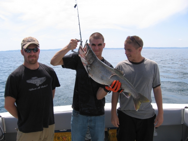 Lake Ontario Area Charter Photos with TSI Charters - The Crew with a hefty Lake Trout